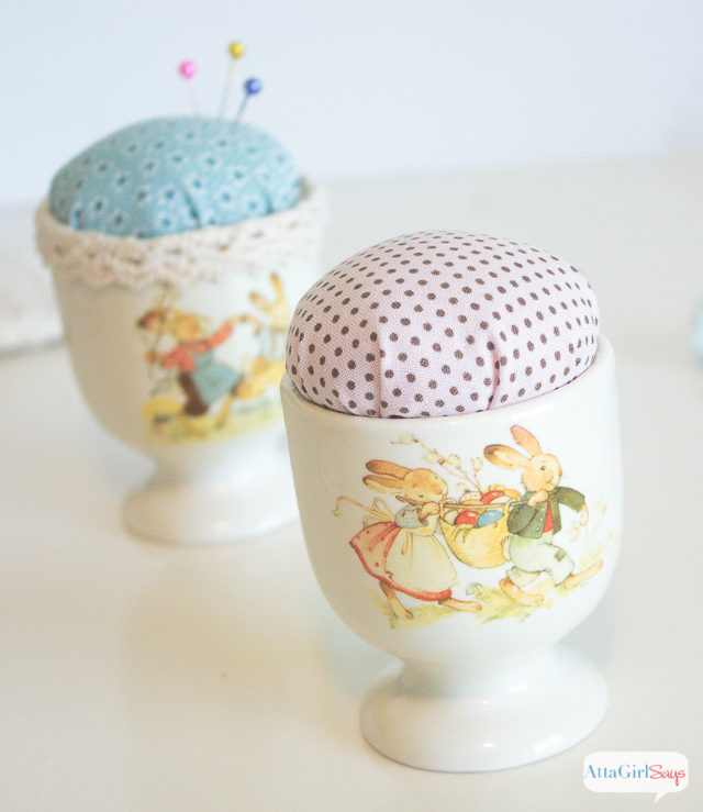 An Easter egg cup pin cushion is even prettier when you embellish it with ribbon and other decorative elements. This project makes a great Easter gift for people who like to sew.