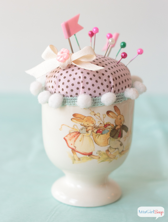 Looking for a way to use all those fabric, trim and ribbon scraps? Why not make a fun Easter pin cushion using an egg cup? So adorable!