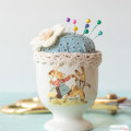 I love the vintage vibe of this DIY pin cushion that is made from fabric and trim scraps and a Nestler Easter egg cup.