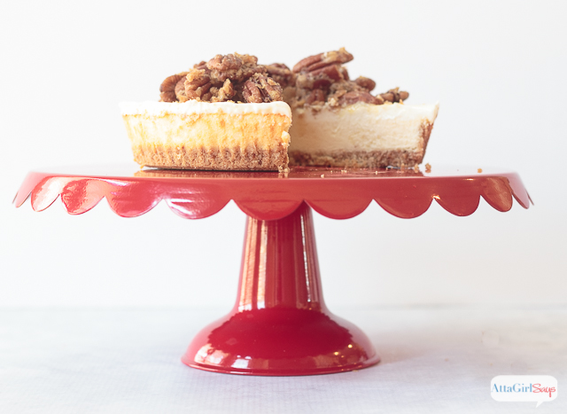 pecan pie cheese cake on a red cake stand