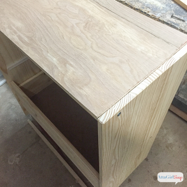 To eliminate the gap on the top of the chest, I added a thin sheet of luan. You can see how the entire Ikea RAST hack transformation on Atta Girl Says. #hickoryhardware #sponsored #ikeahack