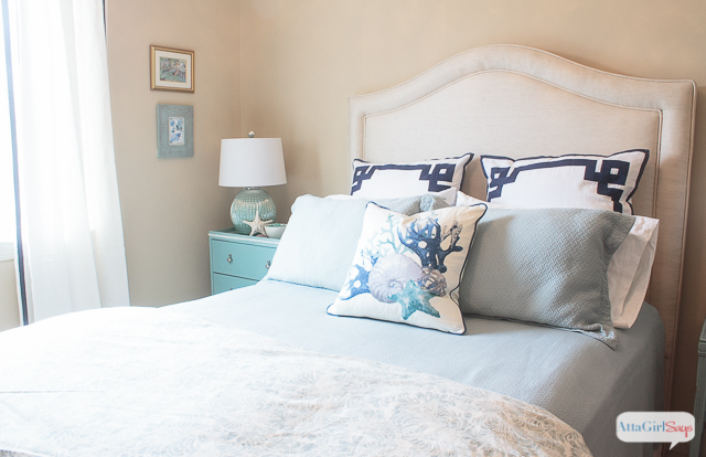 What guest wouldn't like to sleep in this beautiful and comfortable bed? I love all the sophisticated coastal decor in this guest bedroom makeover.