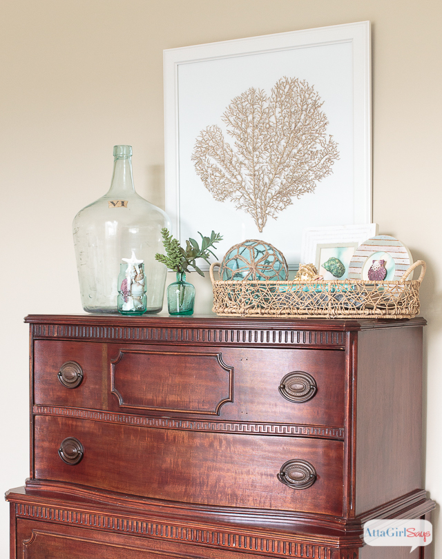 This is such a serene and beautiful guest bedroom transformation. I love all the subtle coastal decor touches and how she mixed old and new pieces, as well as painted and stained wood pieces, like this gorgeous chest of drawers.