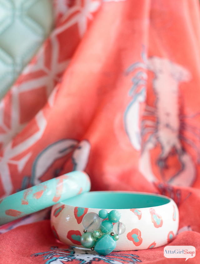 These painted wooden bangle bracelets would make a great Mother's Day gift. There are so many different ways to decorate these. I love the coral and aqua color combination used on these. #decoartprojects #sponsored