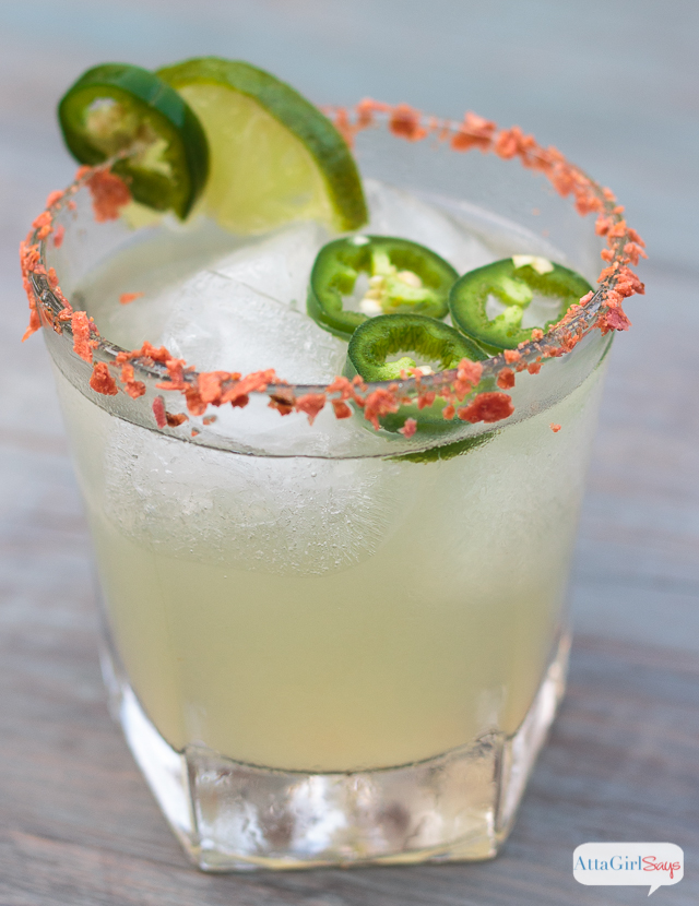 A fiery, slow summertime sipper! This limeade recipe definitely has a kick thanks to the addition of jalapeno-infused bourbon.