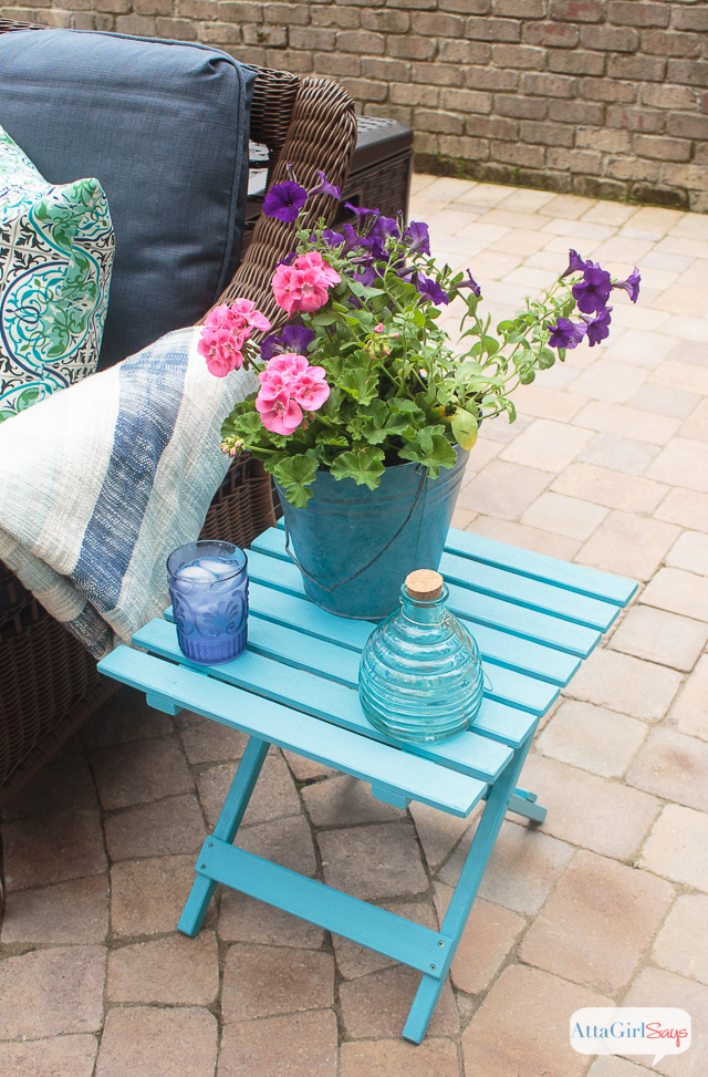 Give wooden outdoor patio furniture a makeover with paint! I love how the turquoise paint transformed this folding side table.