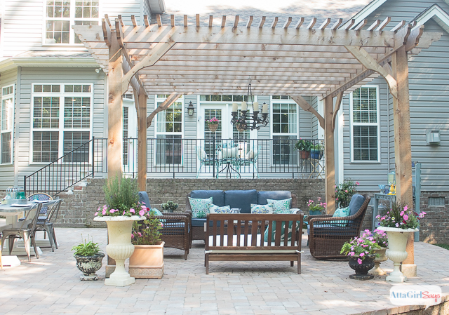 see how we transformed our boring back yard with the addition of a paver patio and