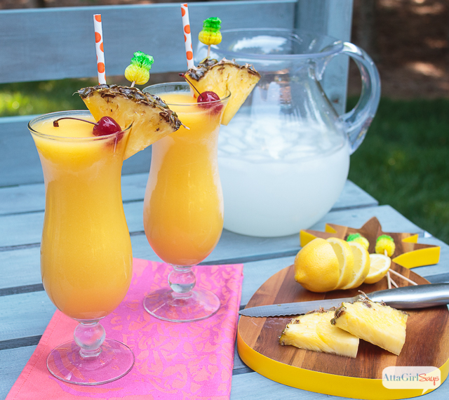 Nothing is better on a hot, summer day than a frozen tropical cocktail. This spiked tropical mango lemonade is made with homemade infused pineapple rum that you can make in less than 10 minutes. Get the recipe. #ad #worldmarkettribe