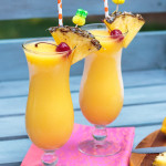 mango frozen lemonade in a hurricane glasses