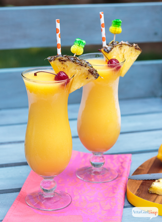 hurricane glasses with frozen tropical mango pineapple lemonade