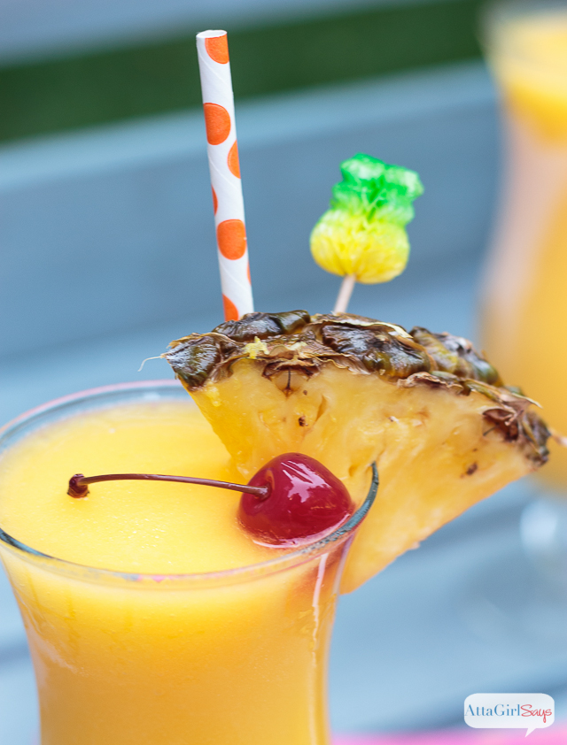 pineapple and cherry garnish on a frozen tropical lemonade cocktail