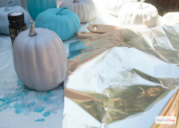 If you're looking for pumpkin decorating ideas, you'll love this one. See how I transformed this cheap foam pumpkins with paint and metallic foil. The after is truly stunning!