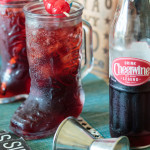 cheerwine bourbon cocktail in a boot shaped glass