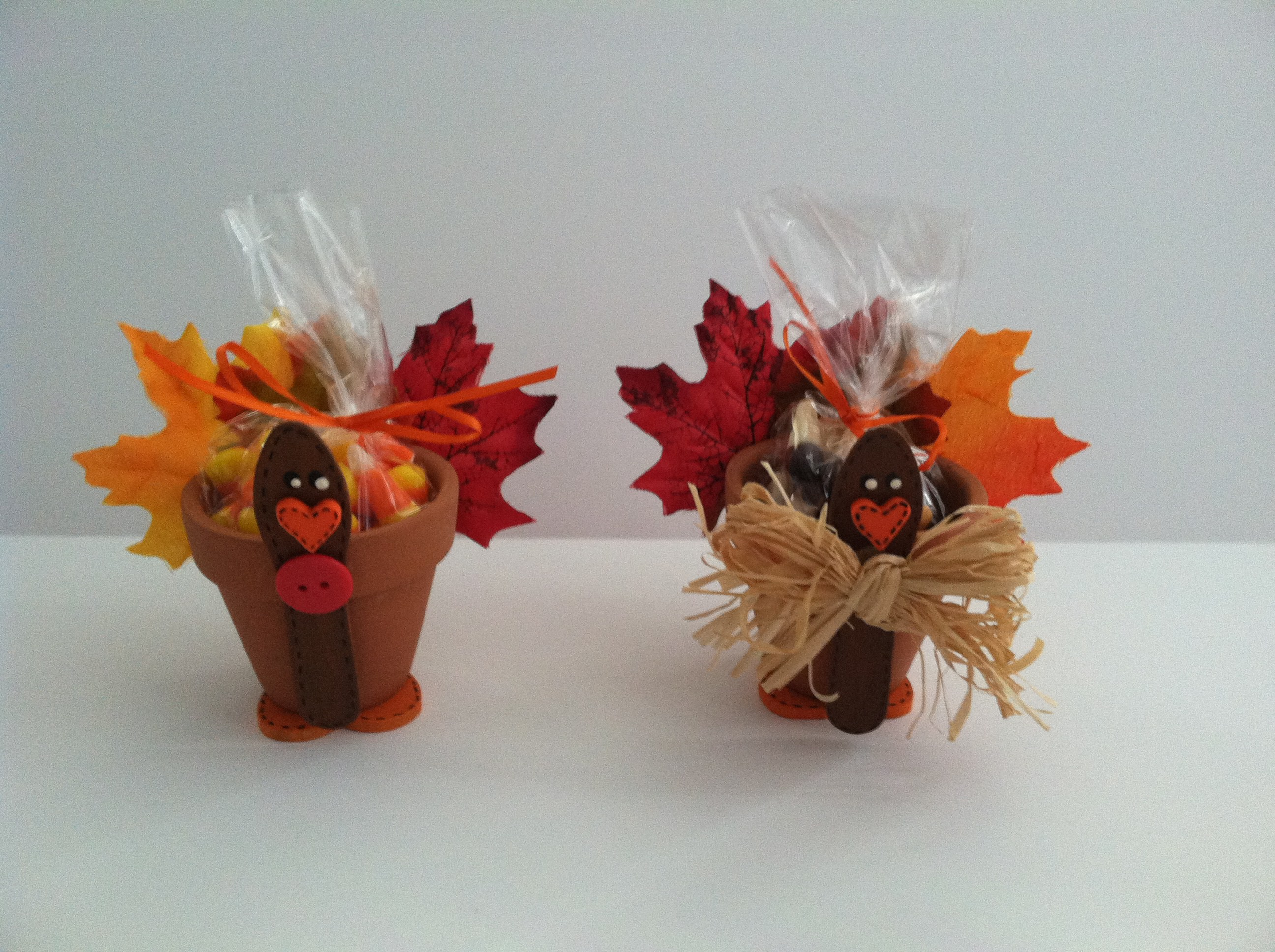 These clay pot turkeys are just one of the adorable Thanksgiving turkey crafts you can make with leaves. Click to find links and instructions for them all.