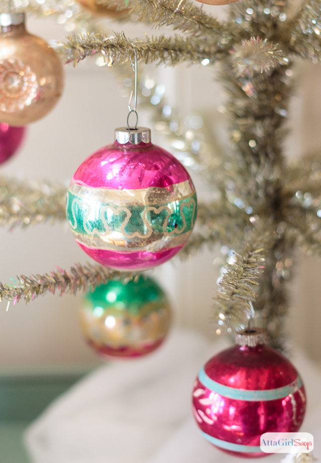 I love the nostalgia of Christmas, and it shows in the vintage decor I use to decorate my home. These vintage Shiny-Brite ornaments hanging on a tinsel tree are just one example of how you can add vintage touches for the holidays.