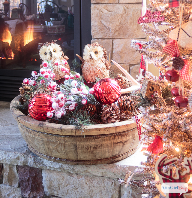 I love all the vintage and rustic Christmas decor she used to decorate this gorgeous stone fireplace mantel for the holidays.