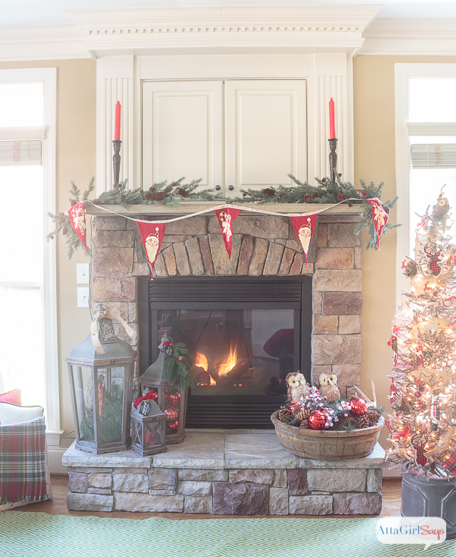 i love all the vintage and rustic christmas decor she used to decorate this gorgeous stone