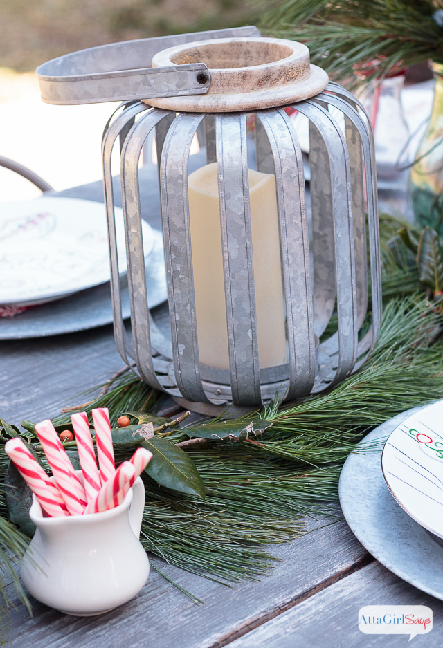 If you live in a temperate climate, invite friends and family over for a Christmas brunch outside. I used simple greenery, galvanized accessories and milk bottles to give our farmhouse table a festive touch.