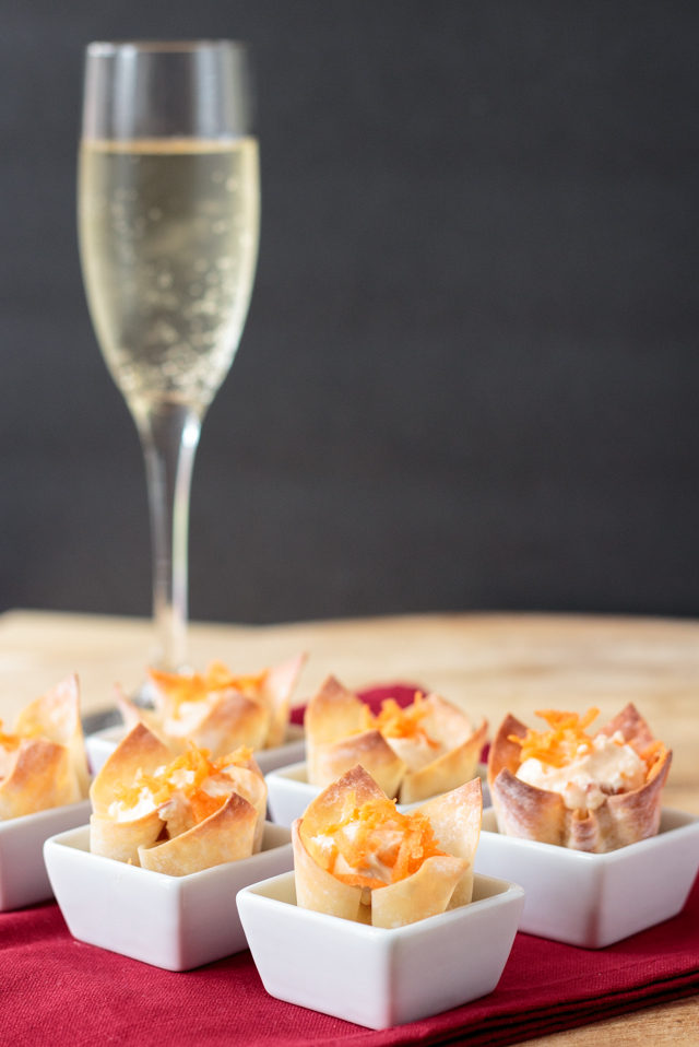 cheese wonton appetizers and a glass of champagne