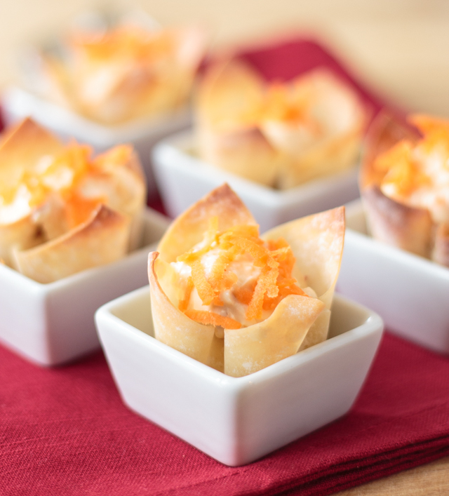 wonton cups in square white appetizer bowls