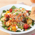 If you're looking for a light and tasty lunch, packed with delicious vegetables, you can't go wrong with this Mediterranean quinoa salad recipe inspired by the Live Med Salad at Zoe's Kitchen. Be sure to try the homemade roasted red pepper dressing, too.