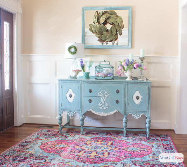 Traditional Foyer With An Aqua Blue Painted Buffet On A Pink And Rug Vintage