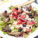 This delicious, light and healthy grilled chicken salad celebrates the bounty of spring with a homemade fruit salsa and tangy poppy seed dressing. #sponsored #FreshWorksFreshness