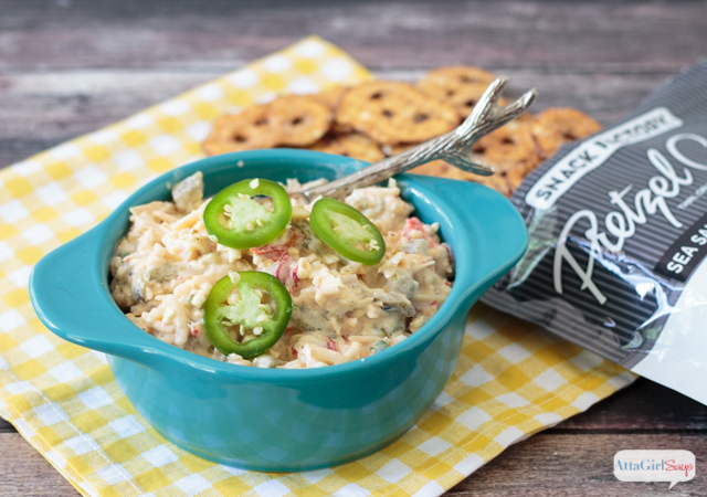 pimento cheese spread with jalapenos in a blue bowl with pretzel crisps