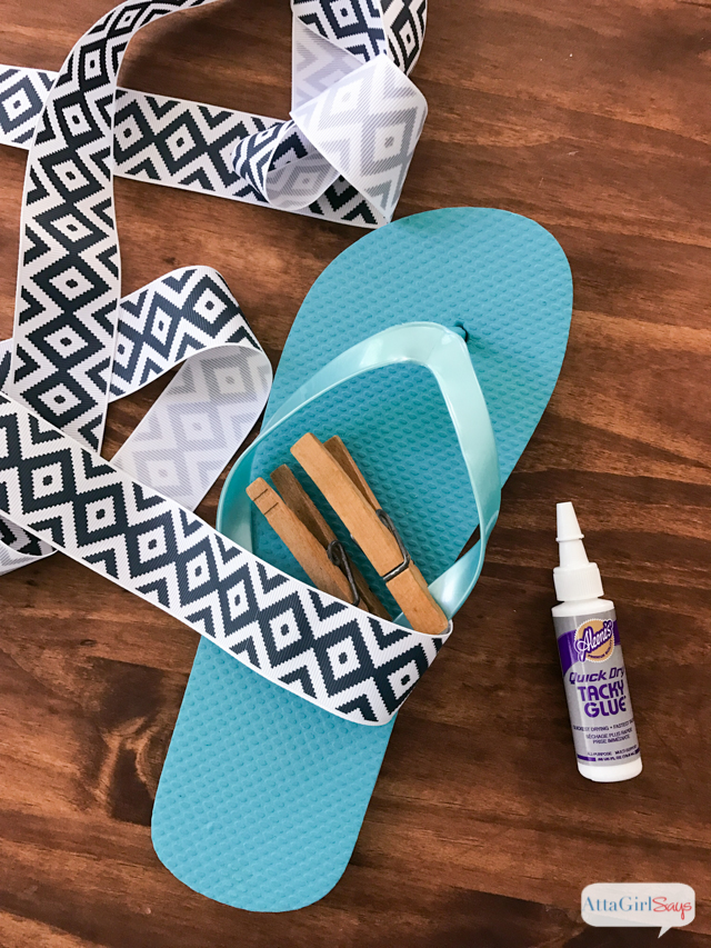 Step 1 for making DIY Bow Flip Flops: Glue grosgrain ribbon to the straps of the shoe, securing with quick drying tacky glue. Secure with a clothespin and continue wrapping around the strap. #sponsored