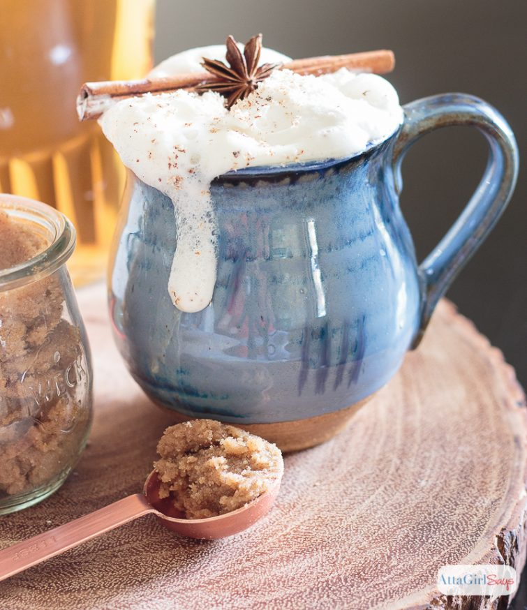 mug of hot buttered rum topped with foam and garnished with anise and cinnamon