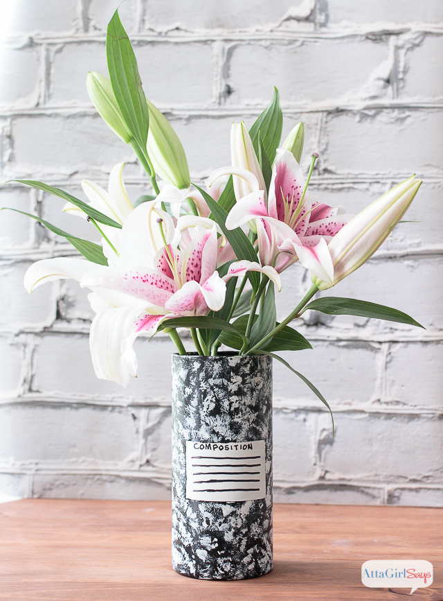 Use paint to transform a clear glass vase into teacher appreciation gifts. This one is painted to look like an old-school composition notebook and filled with a bouquet of beautiful pink and white lilies.