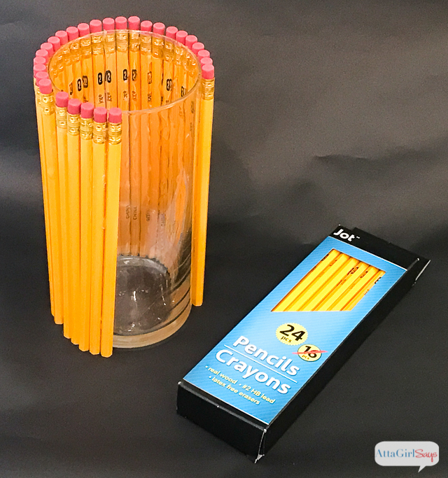 Welcome your favorite teacher back to school with a thoughtful, homemade teacher appreciation gift. This vase is made from dozens of No. 2 pencils affixed to a glass vase. Add a bouquet of gorgeous white lilies and yellow mums.