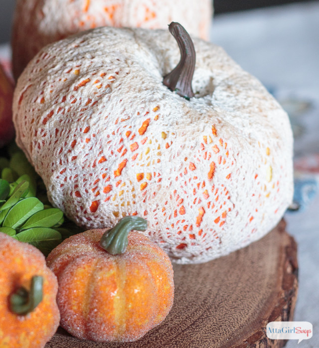 Use crochet lace ribbon and decoupage glue to transform inexpensive foam pumpkins into stunning seasonal decor for fall.