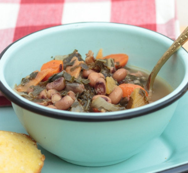 bowl of black eyed pea soup on an aqua tin tray