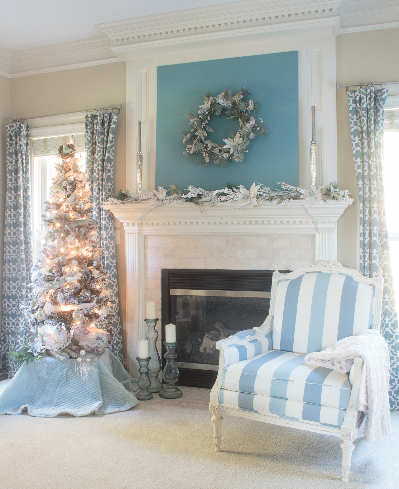 Stunning Blue And White Christmas Decorations Featuring A Flocked Tree,  Mercury Glass,