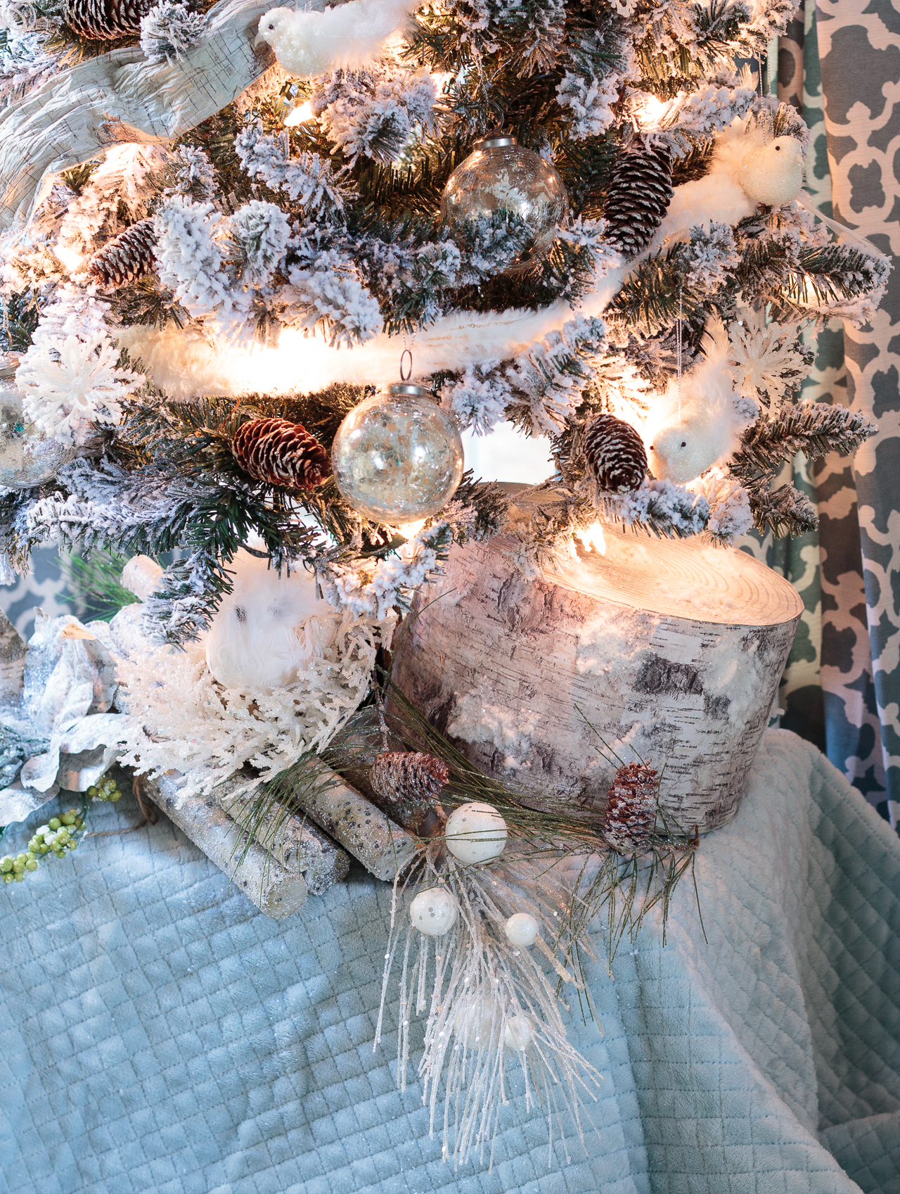 Stunning blue-and-white Christmas decorations featuring a flocked tree, mercury glass, birds and snowy branches. So many wonderful Christmas mantel ideas here. #sponsored #AtHomeStores