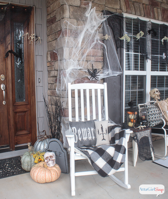 Dress up your front porch for Halloween with simple, inexpensive DIY Halloween decorations. You'll love touring this spooky space.
