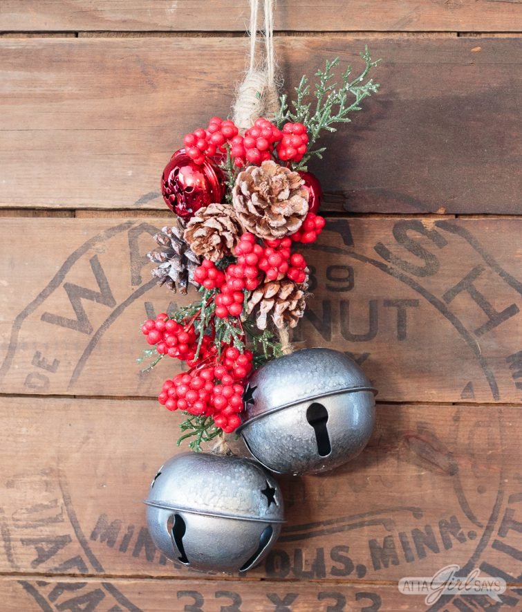Christmas swag hanging on a vintage wooden stove cover