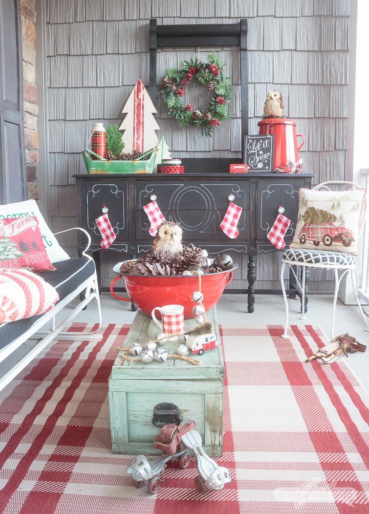 Tour this beautiful southern front porch decorated in vintage style for Christmas. You'll love the use of lanterns, beautiful ribbon and vintage thrifted finds in this stunning space. Which of these Christmas porch decor ideas would you use at your home?