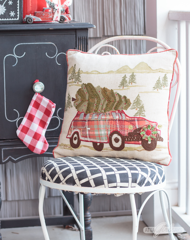 Christmas pillow on a bistro chair