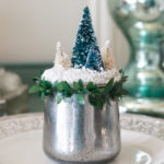 Turn glass yogurt jars into stunning sea glass and mercury glass votives. Add bottlebrush trees, greenery, tinsel and faux snow and use them as part of your Christmas decor. Click for step-by-step instructions and a complete supply list for making them. Plus check out the other ideas for repurposing jars and decorating with jars.