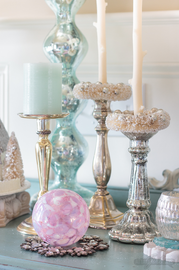 A collection of handblown glass ornaments, bottlebrush wreaths and silver and mercury glass candlesticks look so festive on a handpainted buffet. Stunning Christmas home tour.