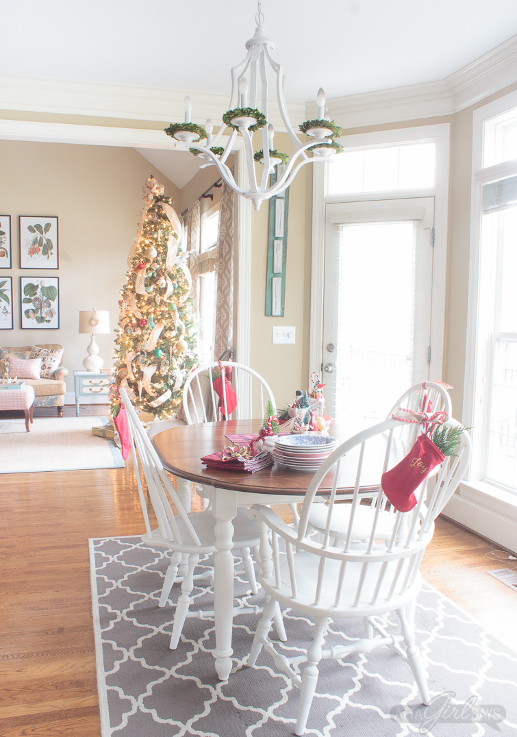What a gorgeous Christmas home tour, full of colorful and vintage decorations with a touch of elegance. You'll love her collection of vintage Shiny-Brite ornaments and all the mercury glass. Don't miss the blue-and-white Christmas decor in the master bedroom or the blue-and-silver color scheme in the family room. So unexpected! And the Christmas tree full of glass ornaments is stunning! Everything is so elegant. Especially the golden dining room! So many great Christmas decorating ideas, especially if you love color, southern traditional decor and vintage items.
