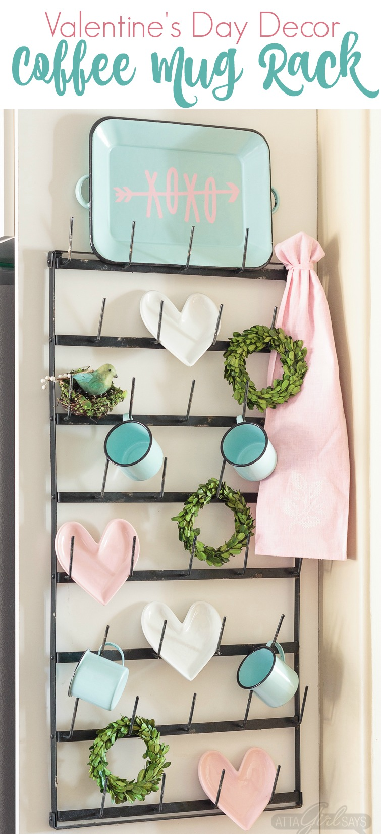 "Dress up your coffee mug wall rack with simple Valentine's Day decor, including a ""Gossip Girl"" inspired quote you can make with your Cricut. Enamel coffee mugs, miniature boxwood wreaths and heart-shaped plates! Swoon. Click for sources to recreate this look! #mugrack #valentinesday #gossipgirl #xoxo #farmhouse #aquaandpink #mugrackmonday #valentinesdecor #cricutmade #cricutmaker #cricutexploreair #quotes"