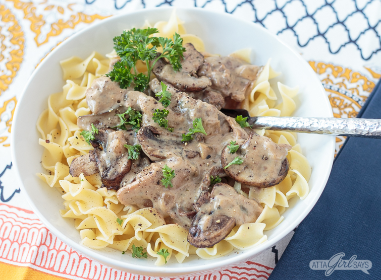 bowl of beef stroganoff over noodles