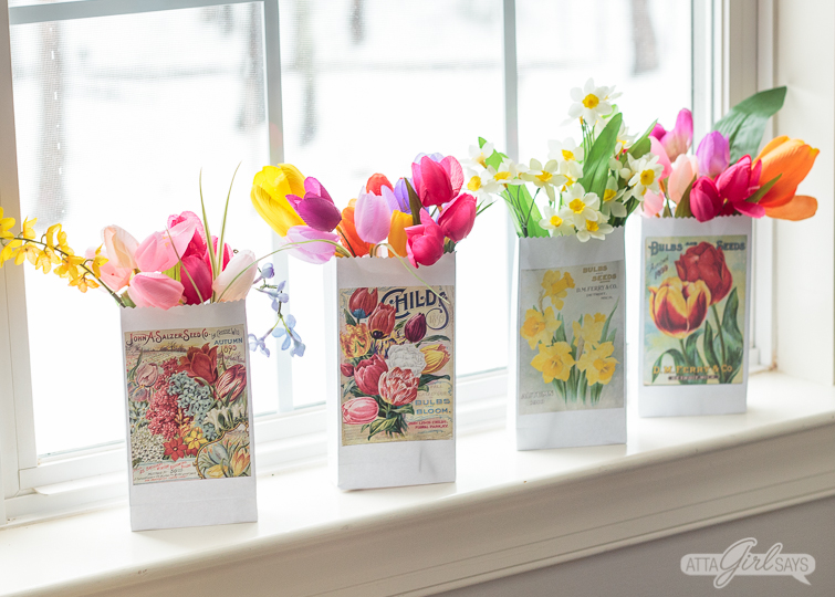 Print and make your own gardening themed party favor bags featuring artwork from vintage seed catalogs. This free collection includes lilies, tulips, daffodils, roses, hyacinths and other gorgeous spring flowers. Download all 22 designs, print them out using your  home computer and learn step-by-step how to fold them into bags with this easy tutorial at AttaGirlSays.com. There's even a video demonstration. #springflowers #partyfavors #papercrafts #seedcatalogs #vintageflorals