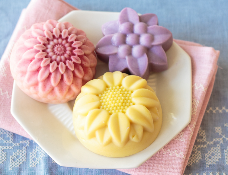 These gorgeous DIY lotion bars are made with nourishing coconut oil and mango butter and scented with floral fragrance oils. They are a great homemade gift idea for Mother's Day, a birthday, Valentine's Day or a bridal shower. Make them in several color and scent combinations to create a bouquet of flower lotion bars. #handmadebeauty #essentialoils #lotionbars #springflowers