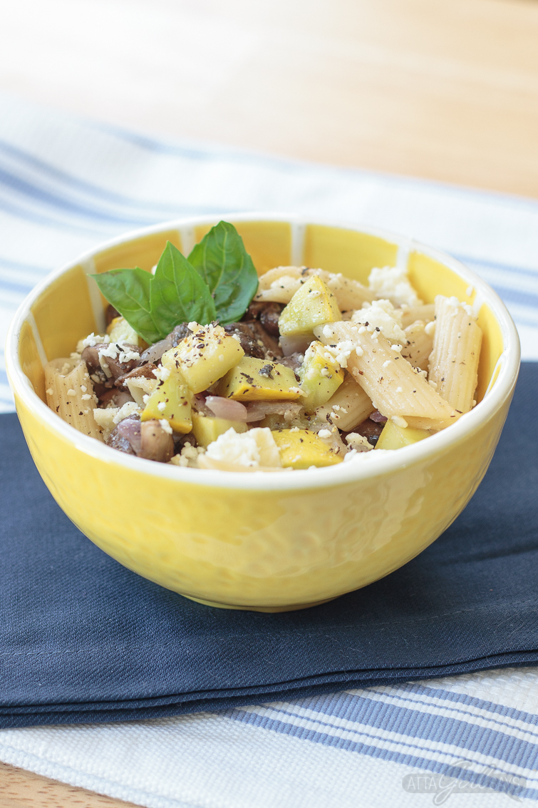 roasted squash vegetable pasta salad in a yellow bowl