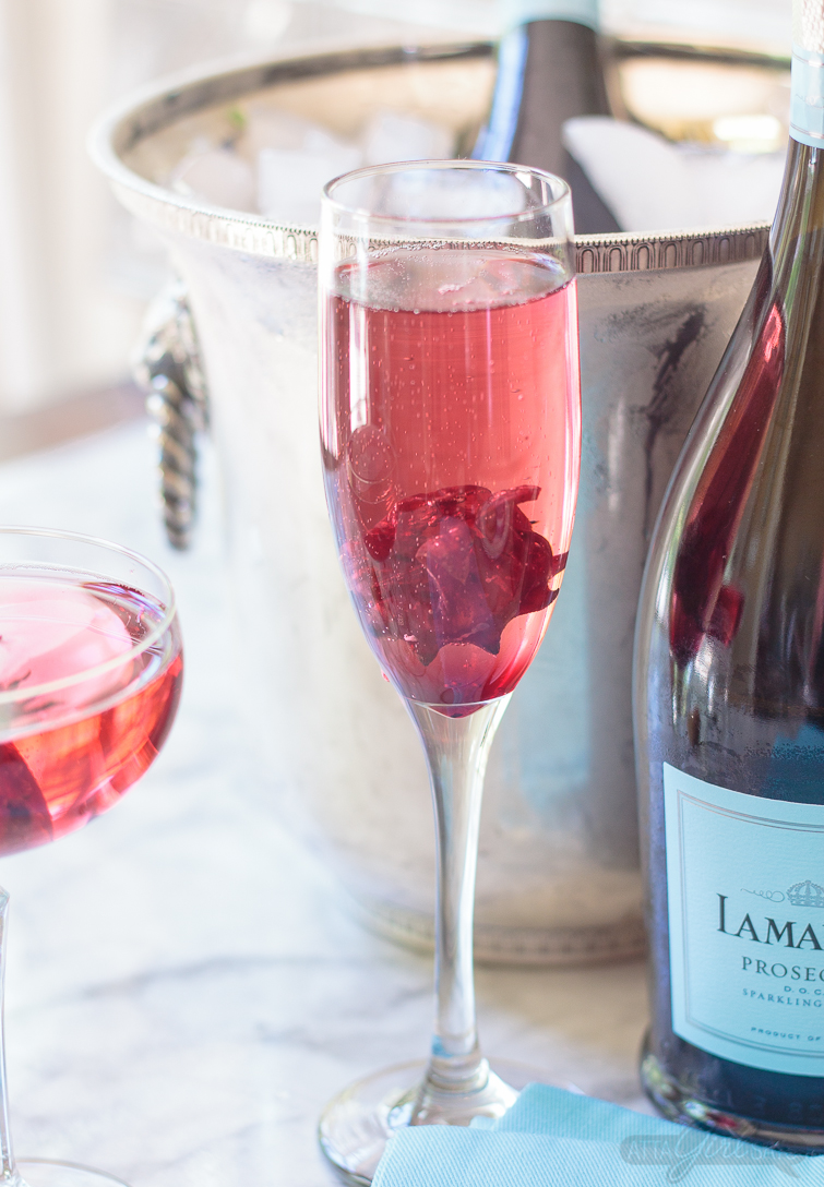 No special occasion necessary. Invite your best gal pals over for brunch and laughs and serve up these delicious pretty pink hibiscus cocktails featuring La Marca Prosecco. Learn how to make infused hibiscus vodka and hibiscus simple syrup to make recipes to make three different versions of the hibiscus Prosecco cocktail, plus ideas for throwing a fabulous brunch. #ad #CelebratorySips #CelebrateWithLaMarca