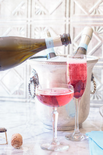 Pouring Prosecco into a champagne flute to make a blooming hibiscus cocktail. No special occasion necessary. Invite your best gal pals over for brunch and laughs and serve up these delicious pretty pink hibiscus cocktails featuring La Marca Prosecco. Learn how to make infused hibiscus vodka and hibiscus simple syrup to make recipes to make three different versions of the hibiscus Prosecco cocktail, plus ideas for throwing a fabulous brunch. #ad #CelebratorySips #CelebrateWithLaMarca